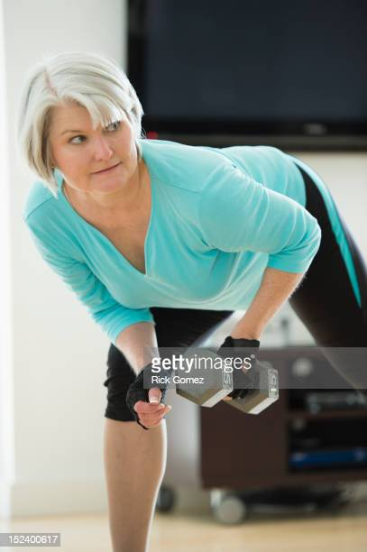 Caucasian woman exercising with hand weights