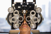 Caucasian woman having eye exam