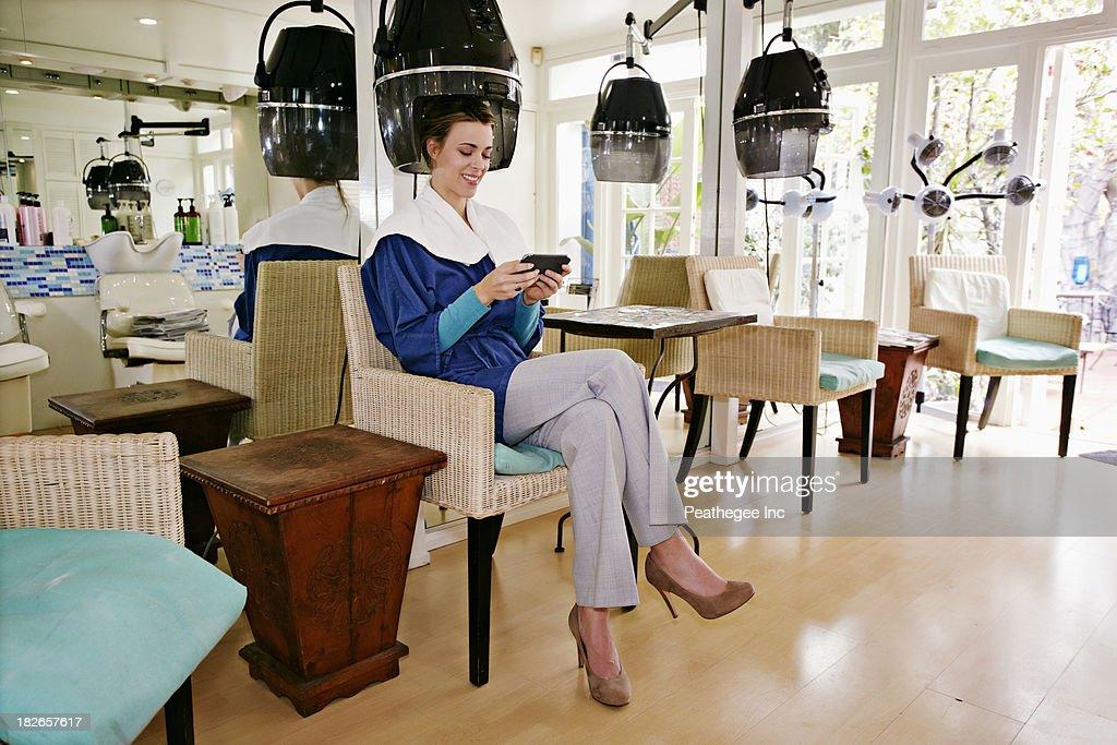 Caucasian woman having hair done in salon
