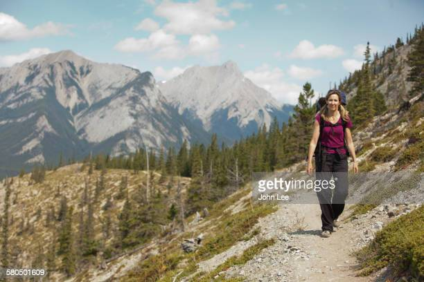 Caucasian woman hiking on remote hillside