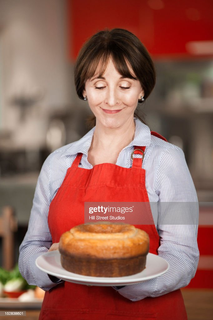 Caucasian woman holding cake : Stock Photo