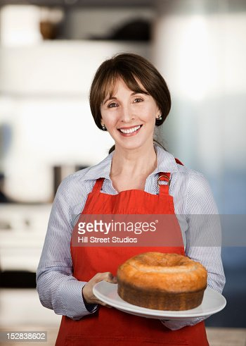 Caucasian woman holding cake : Stock Photo