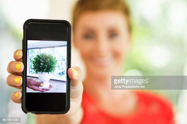 Caucasian woman holding cell phone