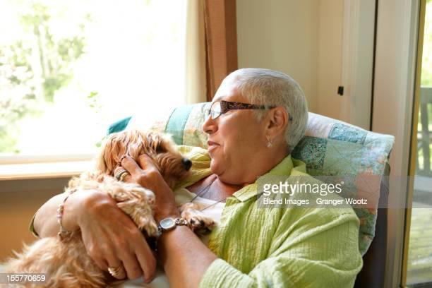 Caucasian woman holding dog