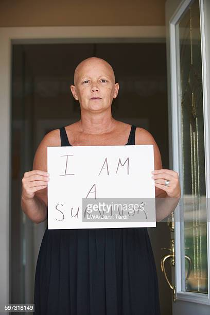Caucasian woman holding empowering sign