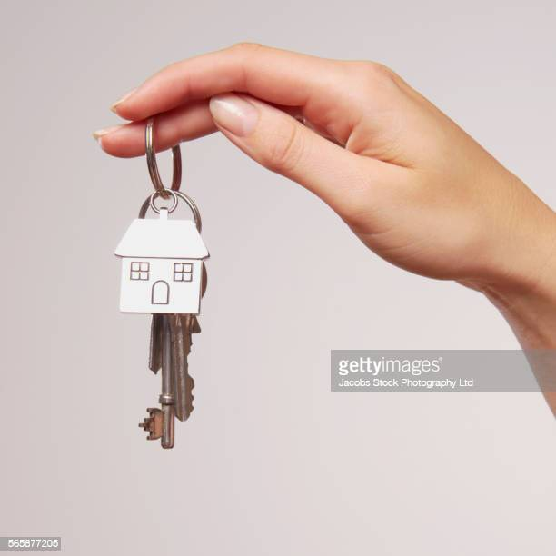 Caucasian woman holding house key chain and keys