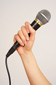 Caucasian woman holding microphone