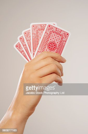 Caucasian woman holding playing cards