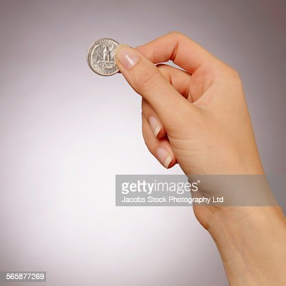 Caucasian woman holding quarter coin