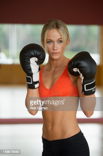 Caucasian woman in boxing gloves exercising