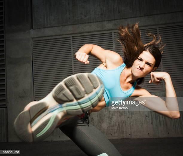 Caucasian woman kicking