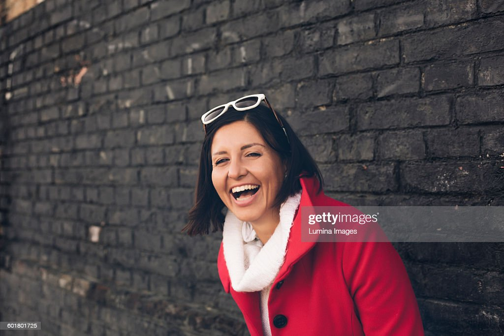 Caucasian woman laughing outdoors