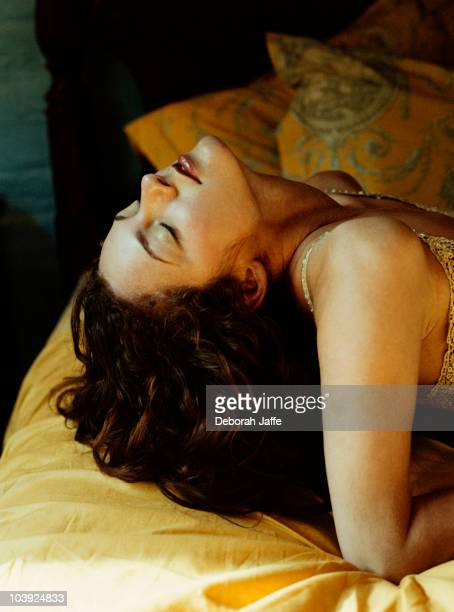 Caucasian woman laying on bed