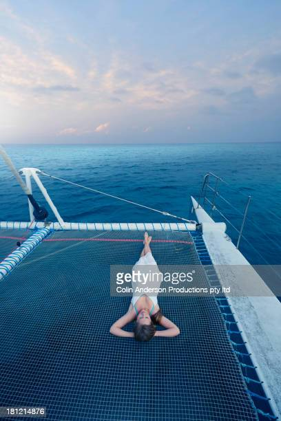Caucasian woman laying on boat