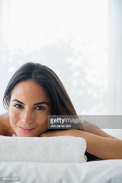 Caucasian woman laying on massage table