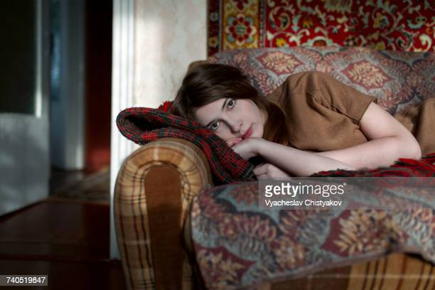 Caucasian woman laying on sofa