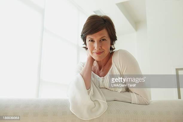 Caucasian woman leaning on sofa