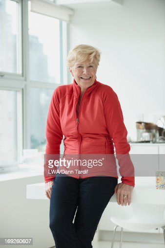 Caucasian woman leaning on table : Stock Photo