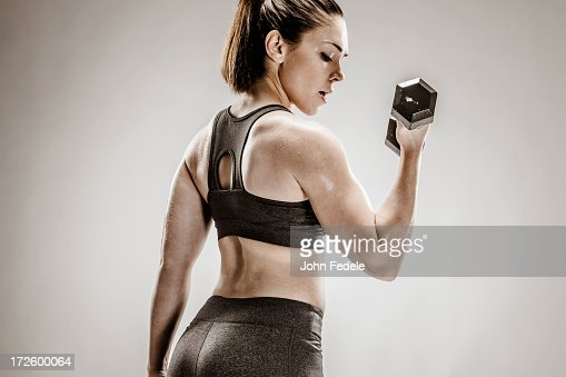 Caucasian woman lifting weights