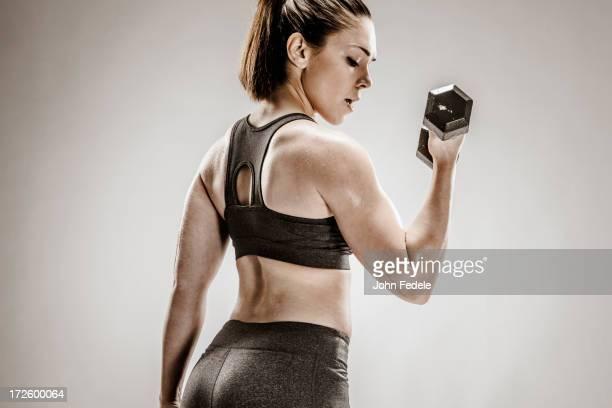 Caucasian woman lifting weights