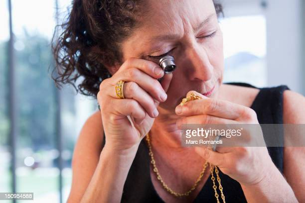 Caucasian woman looking at jewelry in jewelry store