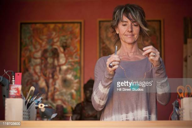 Caucasian woman making jewelry