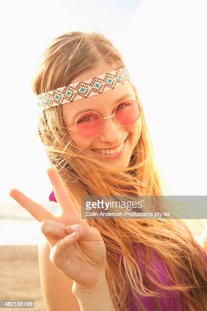 Caucasian woman making peace sign