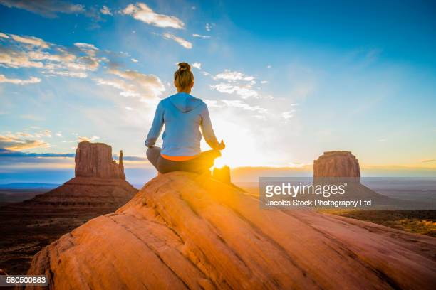Caucasian woman meditating in Monument Valley, Utah, United States