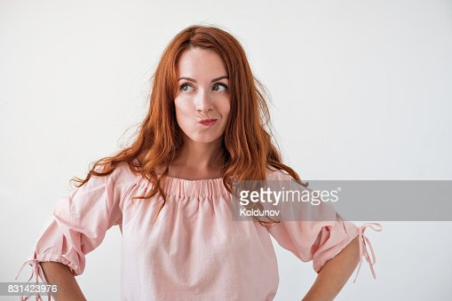 Caucasian woman model with ginger hair posing indoors : Stock Photo