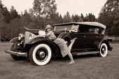 Caucasian woman on vintage car