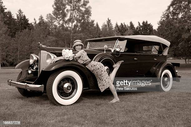 Caucasian woman on vintage car