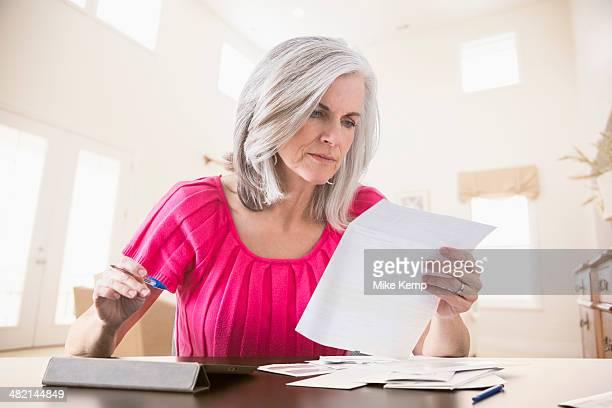 Caucasian woman paying bills online