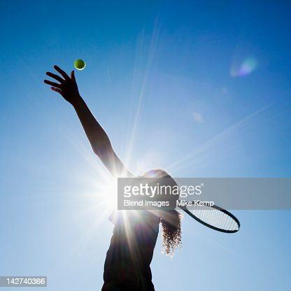 Caucasian woman playing tennis