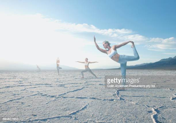 Caucasian woman practicing yoga in desert landscape