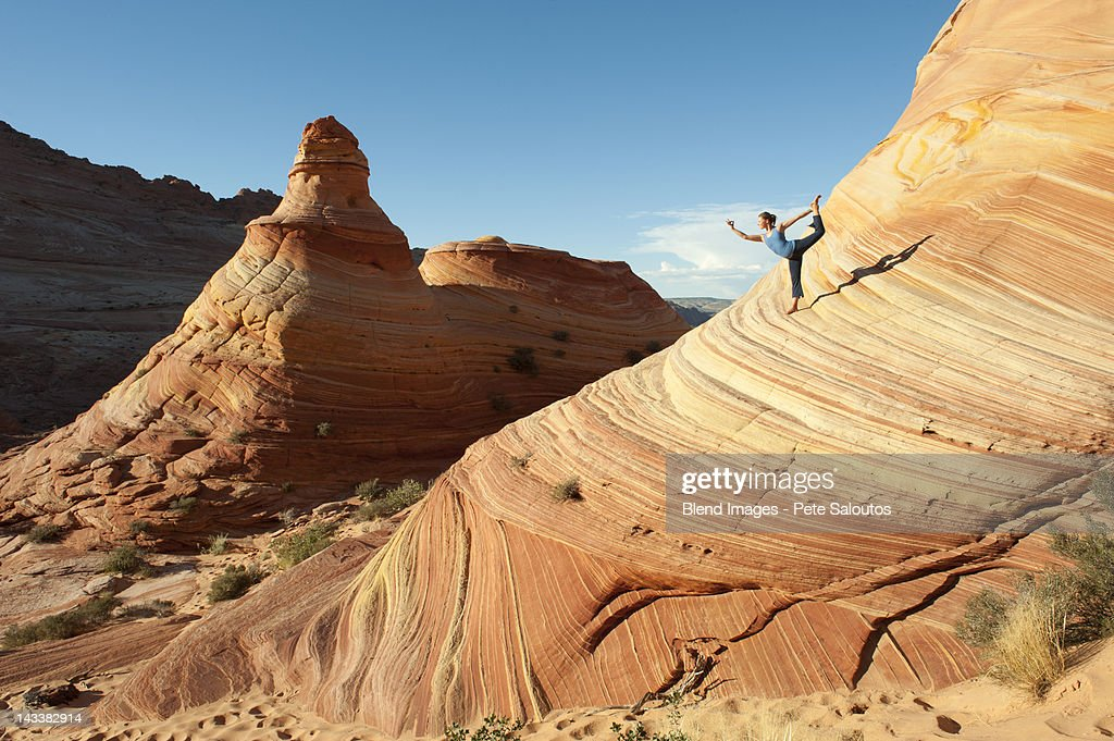Caucasian woman practicing yoga outdoors : Stock Photo