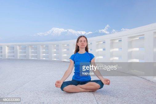 Caucasian woman practicing yoga : Stock Photo