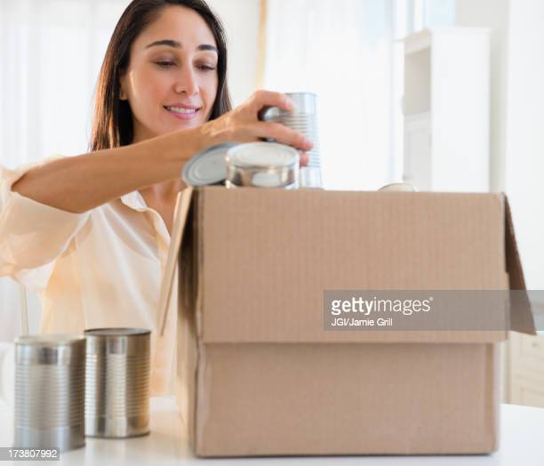 Caucasian woman recycling cans