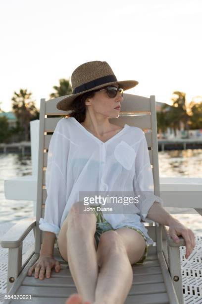 Caucasian woman relaxing in deck chair