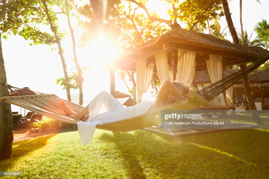 Caucasian woman relaxing in hammock