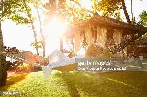Caucasian woman relaxing in hammock
