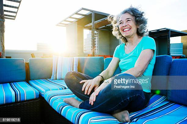 Caucasian woman relaxing on urban rooftop