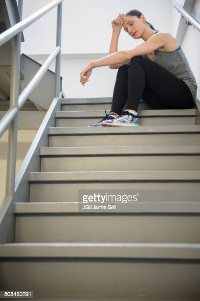 Caucasian woman resting after exercise