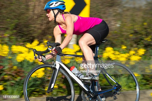 Caucasian woman riding bicycle : Stock Photo