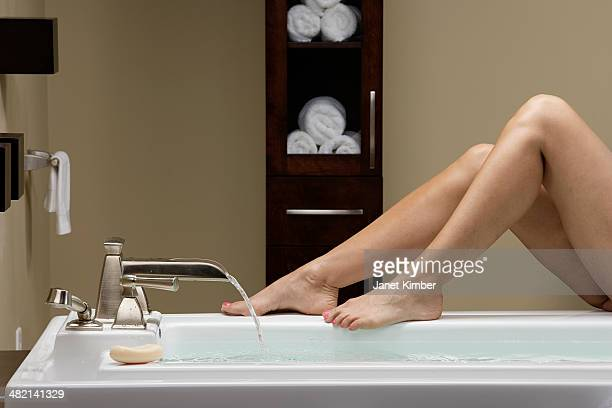 Caucasian woman running bath