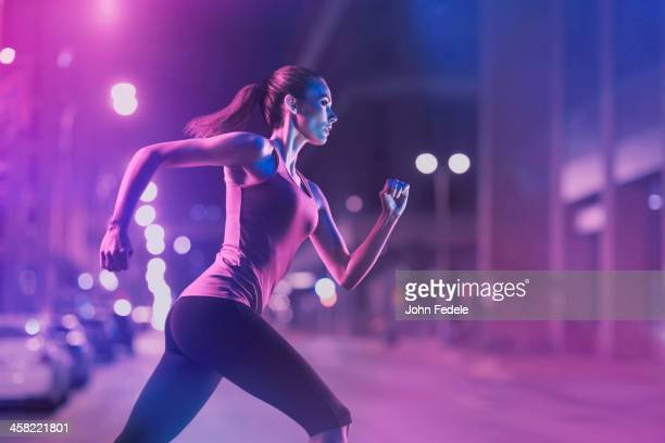 Caucasian woman running on city street