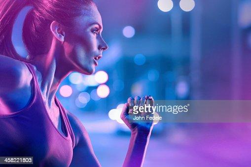 Caucasian woman running on city street