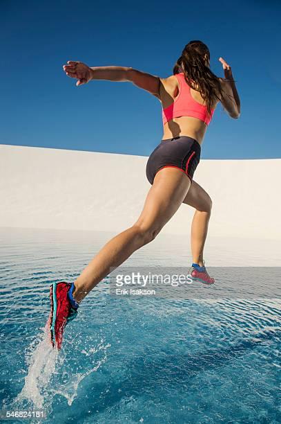 Caucasian woman running on water surface