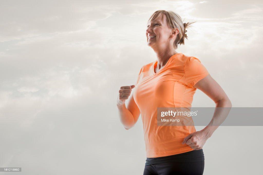 Caucasian woman running : Stock Photo