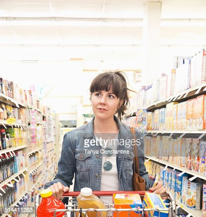 Caucasian woman shopping for groceries in store