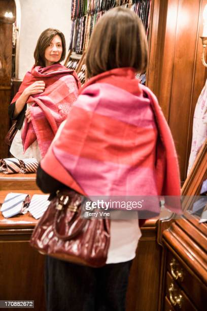 Caucasian woman shopping for scarf